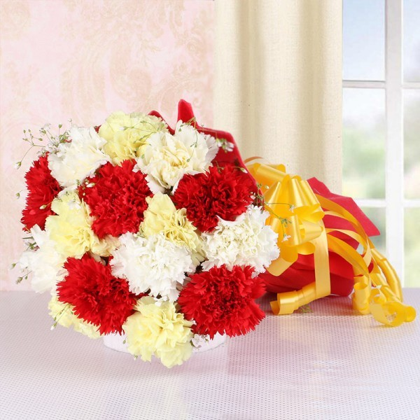 15 Assorted Carnations in Red Paper packing