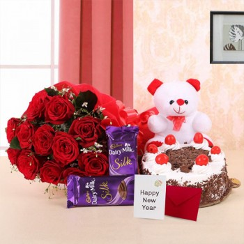 10 Red Roses in Paper Packing with 2 Cadbury's Dairy Milk Silks and Black Forest Cake (Half Kg) and 1 Teddy Bear (6 Inches) along with New Year Greeting Card (6 inches)