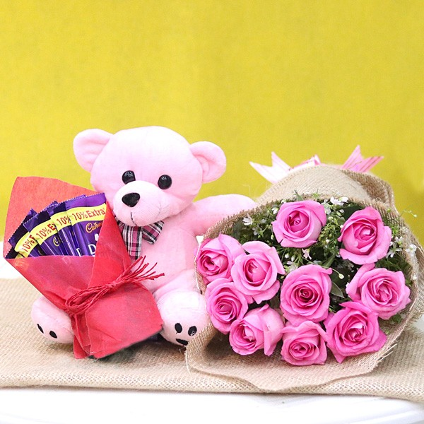 10 Pink Roses wrapped in Jute Packing with Pink Teddy Bear (6 inches) and 5 Dairy Milk Chocolate (13.2 gm)