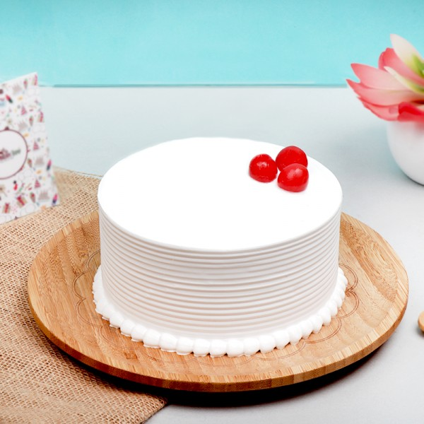 Half Kg Vanilla Cream Cake Topped with Cherries