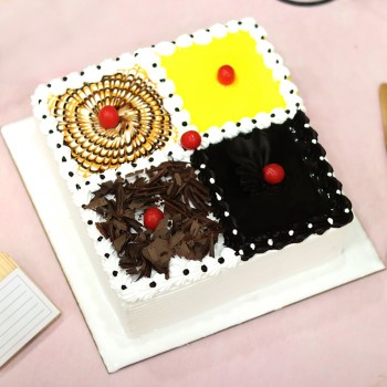 One Kg Square Shape 4 in 1 flavour cake such as Chocolate,Pineapple,Black Forest,Butterscotch