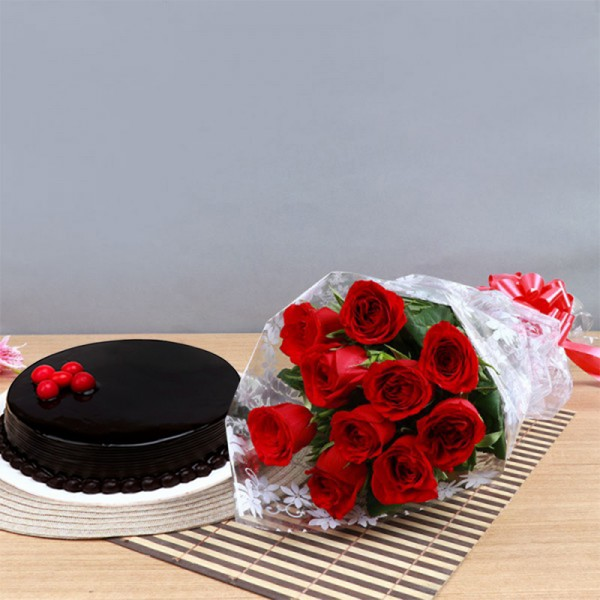 One Bouquet of 10 Red Roses in Cellophane Packing with 1/2 Kg Chocolate Cake topped with Fresh Strawberries