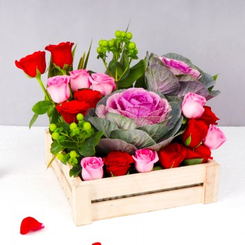 6 Pink Roses,4 Red Roses,2 Green Berries,2 Purple Brassica basket arrangement