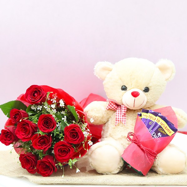 10 Red Roses wrapped in Paper Packing with Teddy Bear (12 inches) and 5 Dairy Milk Chocolate (13.2 gm)