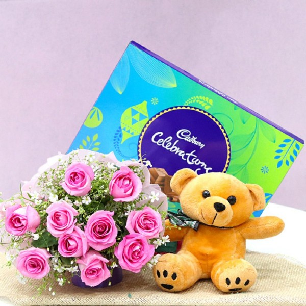 10 Pink Roses wrapped in Paper Packing with Brown Teddy Bear (6 inches) and One Cadbury Celebration (141.4 gm)