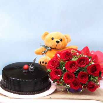10 Red Roses wrapped in paper packing with Half Kg Chocolate Cream Cake and Teddy Bear (6 inches)