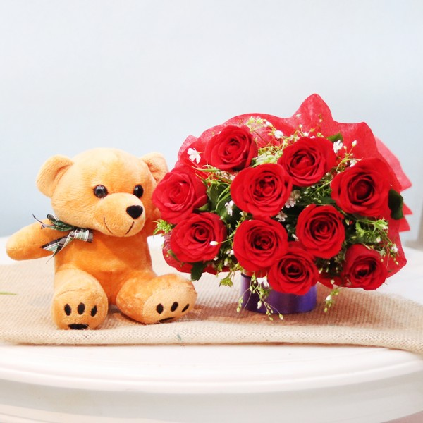 10 red roses in Paper Packing with 6 inches teddy