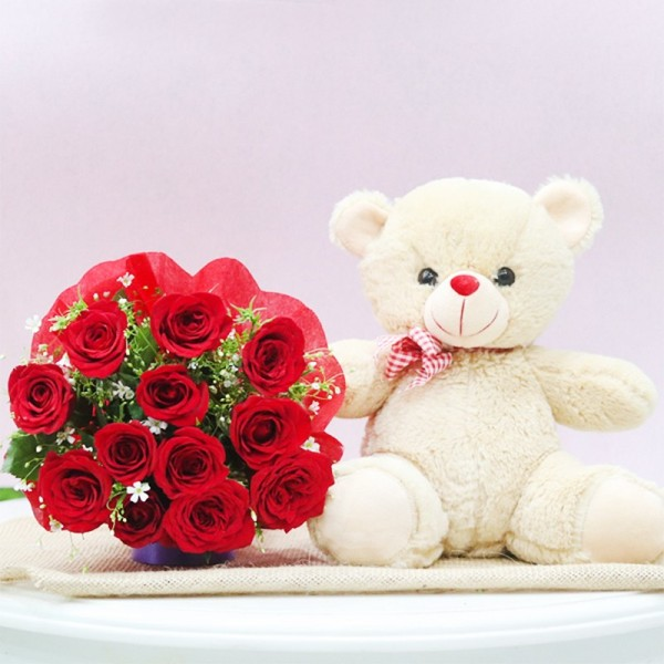12 Red Roses in Red Paper Packing with Teddy Bear 12 inches