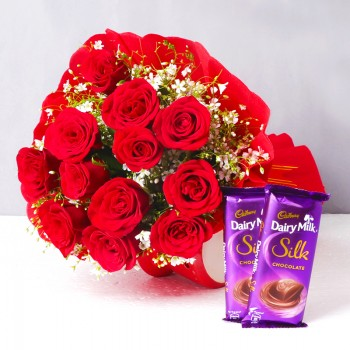 12 Red Roses in Paper Packing with 2 Cadbury's DairyMilk Silk (60 gms each)