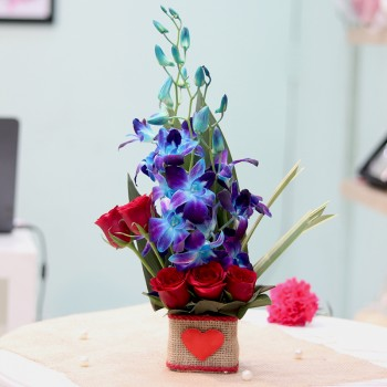 5 Red Roses and 4 Blue Orchids in a Glass Vase
