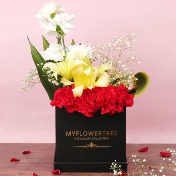 4 White Carnations,4 Red Carnations,3 Yellow Asiatic Lilies Arrangement in Black MFT Luxury Box