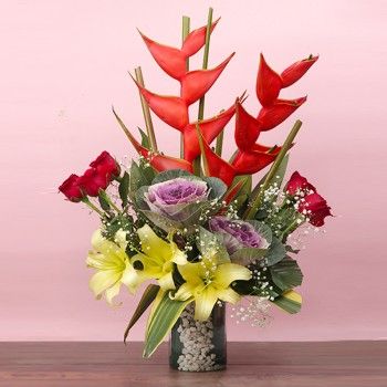 2 Red Heliconia,6 Red Roses,3 Yellow Asiatic Lilies,2 Purple Brassila Flowers Glass Vase Arrangement