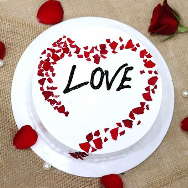 Half Designer Vanilla Cream Cake Decorated with Rose Petals in Heart Shape