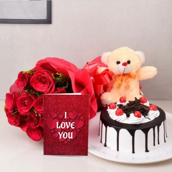 12 Red Roses in Paper Packing with Half Kg Black Forest Cake and Teddy bear (6 Inch) and Valentines Day Greeting Card