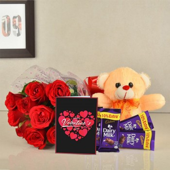 10 Red Roses with Teddy bear (6 inch) and 5 Dairy Milk (13.2 gm) and Greeting Card Valentines Day