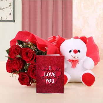 6 Red Roses wrapped in a Red paper and a Red bow with 1 Teddy Bear (6 Inches) and Greeting Card Valentines Day