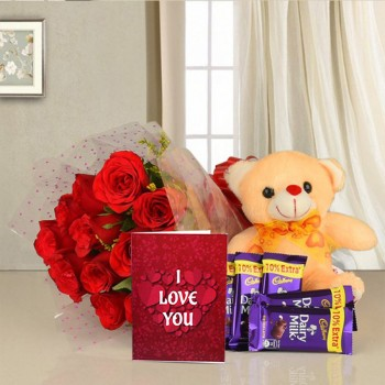 12 Red Roses in Cellophane Packing with 5 Cadbury's DairyMilk Chocolates (13.2 gms each) and 1 Teddy Bear (6 inches) along with Valentines Day Greeting Card