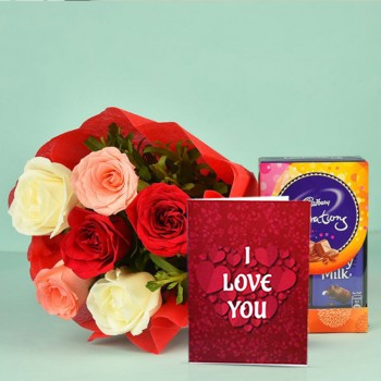 6 Assorted Roses in a paper packing with Celebration Pack ( 65 gm) and Valentines Day Greeting Card
