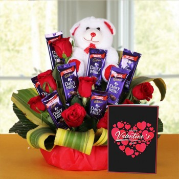 8 Red Roses with 8 Cadbury's DairyMilk Chocolates (14gms each) and Teddy Bear (6 inches) and Valentines Day Greeting Card in a Basket