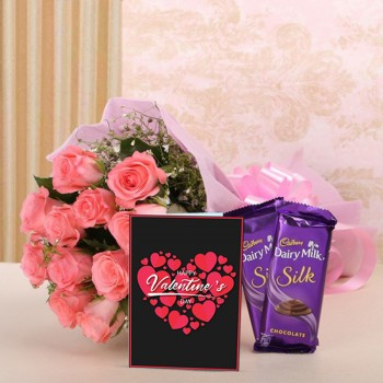 12 Pink Roses in Pink Paper with 2 Cadbury's Silk (60 gms each) and Greeting Card Valentines Day