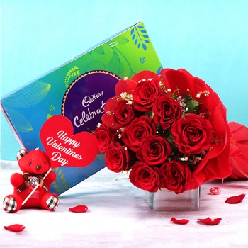 """10 Red Roses in Paper Packing with One Cadbury Celebration Box (141.4 gm) and One Teddy Bear (3 inches) with """"Happy Valentines Day"""" Tag"""