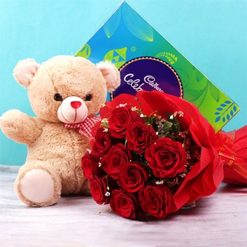 10 red roses in Paper Packing with One Cadbury Celebration Pack (141.4 gm) and 12 inches Teddy Bear