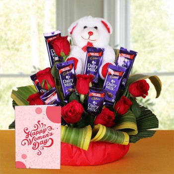 8 Red Roses with 8 Cadbury's DairyMilk Chocolates (14gms each) and Teddy Bear (6 inches) and Womens Day Greeting Card in a Basket