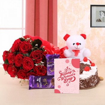 10 Red Roses in Paper Packing with 2 Cadbury's Dairy Milk Silks and Black Forest Cake (Half Kg) and 1 Teddy Bear (6 Inches) - Womens Day Greeting Card