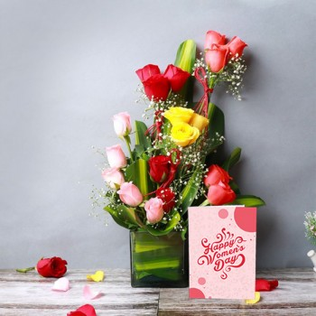 Arrangement of 18 Mixed Roses (Red,Light Pink,Yellow) in Glass Vase with leaves and Womens Day Greeting Card