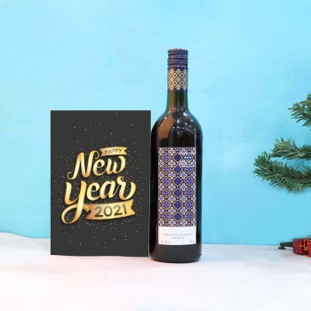 Bottle of Red Wine and New Year Greeting Card