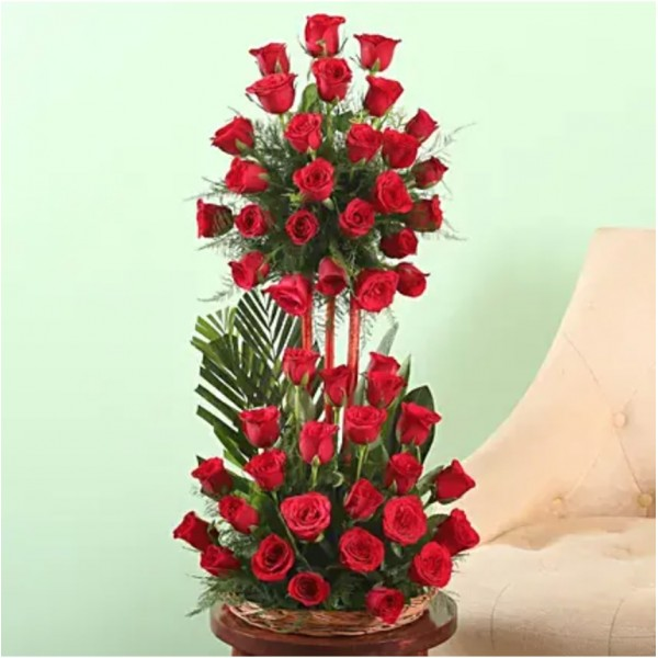 3 tiered floral arrangement of 50 Red Roses in a Basket