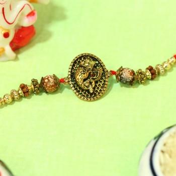 Gold Ganesha Rakhi