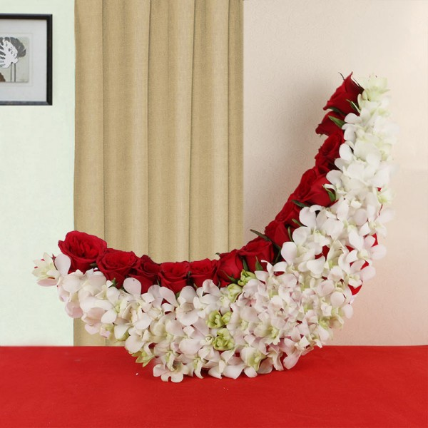 Moon-shaped arrangement of 25 Red Roses and 10 White Orchids