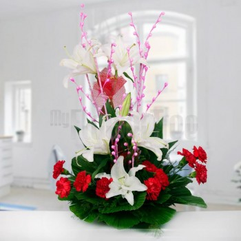 6 Asiatic White Lilies and 10 Red Carnations arranged in a Basket