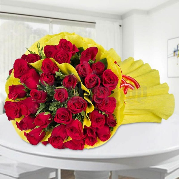50 Red Roses wrapped in yellow special paper