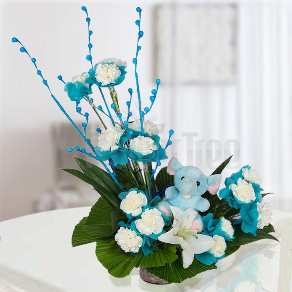15 White Carnations with 1 White Asiatic lilly and 6 Inches Teddy Toys arranged in a Basket