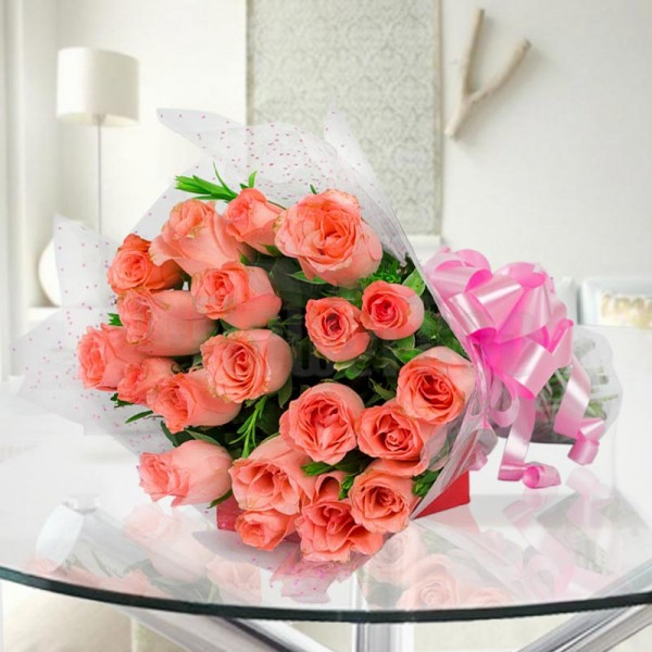 20 Light Pink Roses wrapped in cellophane