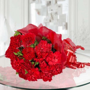12 Red Carnations wrapped in red special paper