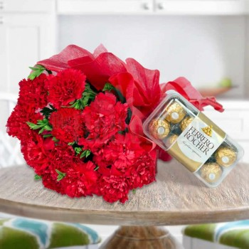 12 Red Carnations wrapped in crape paper with 16 Pcs Ferrero Rocher