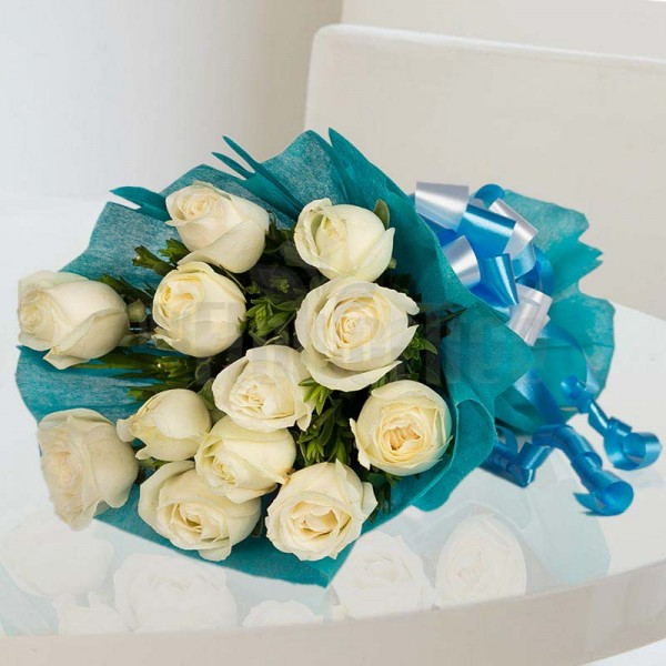 12 White Roses wrapped in blue special paper