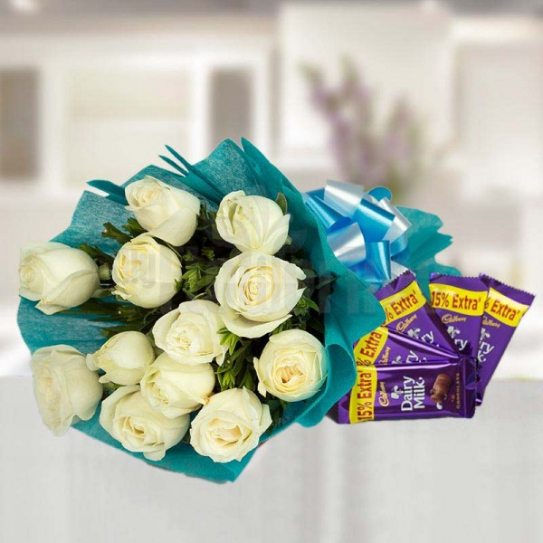 12 White Roses wrapped in crape paper with 5 Dairy Milk Chocolates (13.2 Gms)