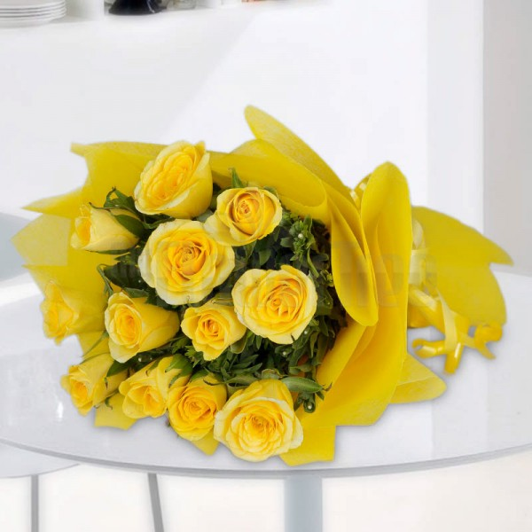 12 Yellow Roses wrapped in yellow special paper