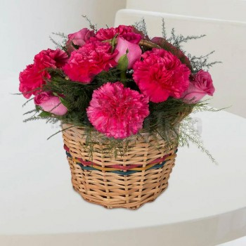 6 Pink Carnations with 6 Pink Roses arranged in a Basket