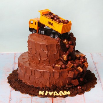 3 kg 3 Tier Chocolate Cream Cake Topped with Snicker,Cadbury Dairy Milk Shots and Oreo Biscuits with a Toy Truck
